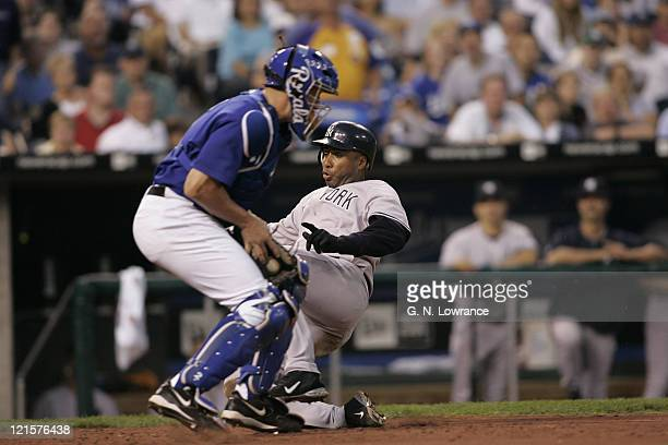 Bernie Williams of the New York Yankees scores ahead of the tag during a game against the Kansas City Royals at Kauffman Stadium in Kansas City Mo...
