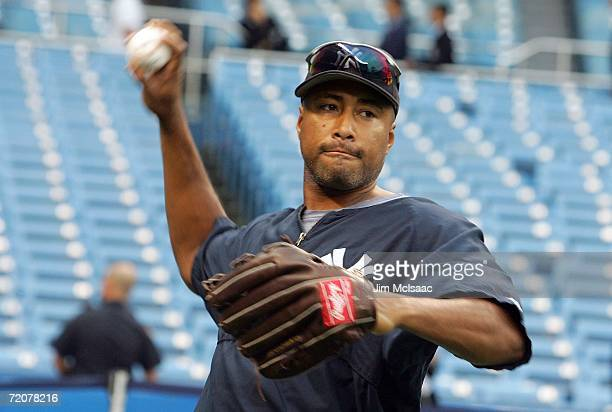 Bernie Williams of the New York Yankees throws during batting practice prior to the start of game one of the American League Division Series against...