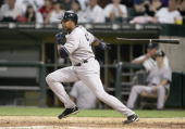 Bernie Williams of the New York Yankees tosses the bat during the game against the Chicago White Sox on August 9 2006 at US Cellular Field in Chicago...