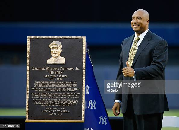 Bernie Williams stands next to his plaque during the ceremony to retire his number in Monument Park before the game against the Texas Rangers at...