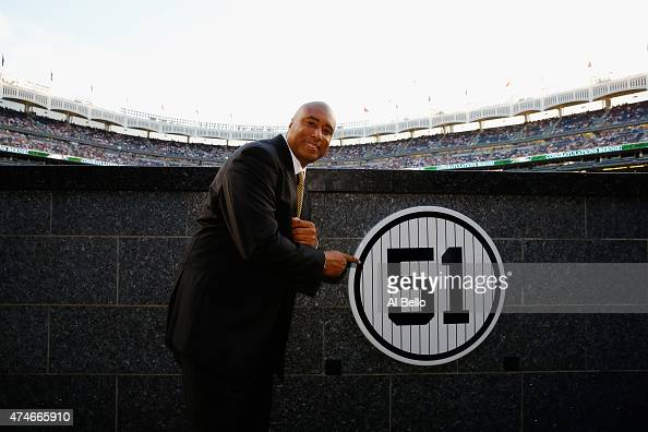 Bernie Williams stands next to his retired number in Monument Park prior to the game between the New York Yankees and the Texas Rangers at Yankee...