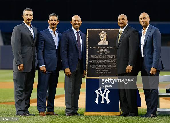 Bernie Williams stands with Andy Pettitte Jorge Posada Mariano Rivera and Derek Jeter during the ceremony to retire Bernie Williams number in...