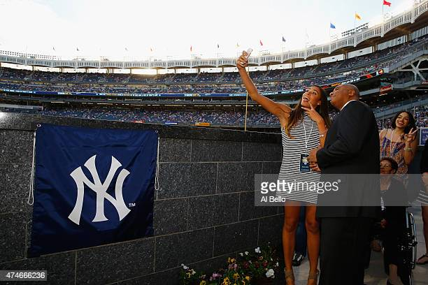 Bernie Williams takes a selfie with his family prior to unveiling his retired number in Monument Park before the game between the New York Yankees...