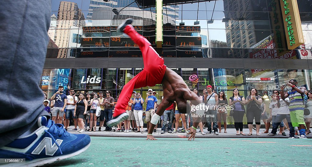 Bernie Young flips while performing for the crowd in the midday heat near Times Square on July 16, 2013 in New York City. The worst heat wave of the summer has descended on the city with temperatures in the mid-90's today.