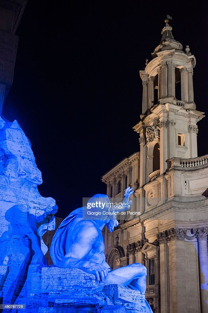 Bernini's Fiumi Fountain in Piazza Navona is lit up in blue during Christmas holidays on December 23, 2014 in Rome, Italy.
