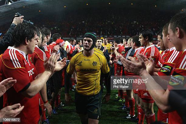 Berrick Barnes of Australia leads his side off the field following the tour match between Munster and the Australian Wallabies at Thomond Park on...