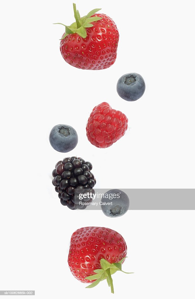Berries against white background, overhead view, close-up