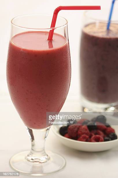 Berries and smoothies with straw