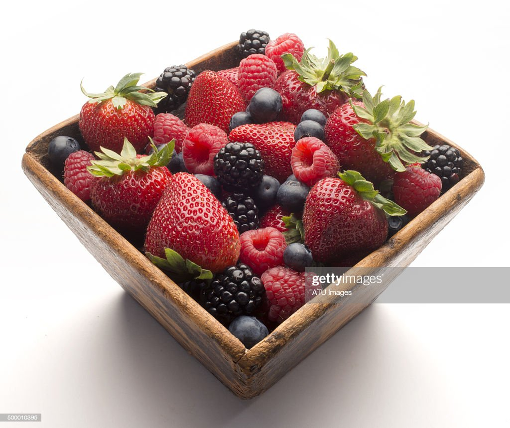 Berries in wood box on white