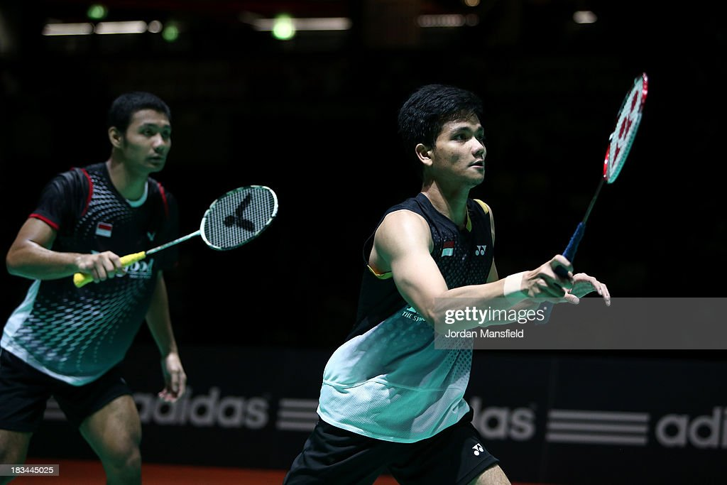 Berry Angriawan (R) and Ricky Karanda Suwardi (L) of Indonesia prepare to receive serve during their Men's Doubles Final match against Mathian Boe and Carsten Mogensen of Denmark during Day 6 of the London Badminton Grand Prix at The Copper Box on October 6, 2013 in London, England.