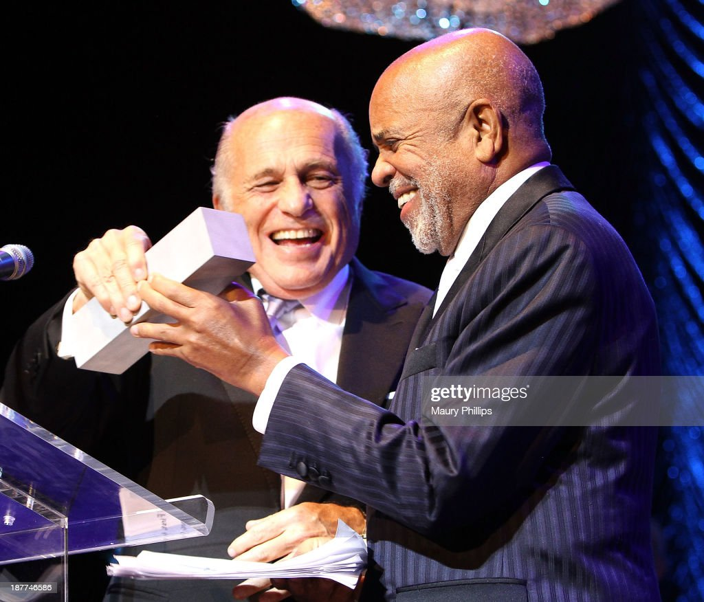 Berry Gordy (R) receives the Architects of Sound Award presented by <a gi-track='captionPersonalityLinkClicked' href=/galleries/search?phrase=Doug+Morris&family=editorial&specificpeople=830291 ng-click='$event.stopPropagation()'>Doug Morris</a> (L) during Architects of Sound: Motown at The GRAMMY Museum on November 11, 2013 in Los Angeles, California.