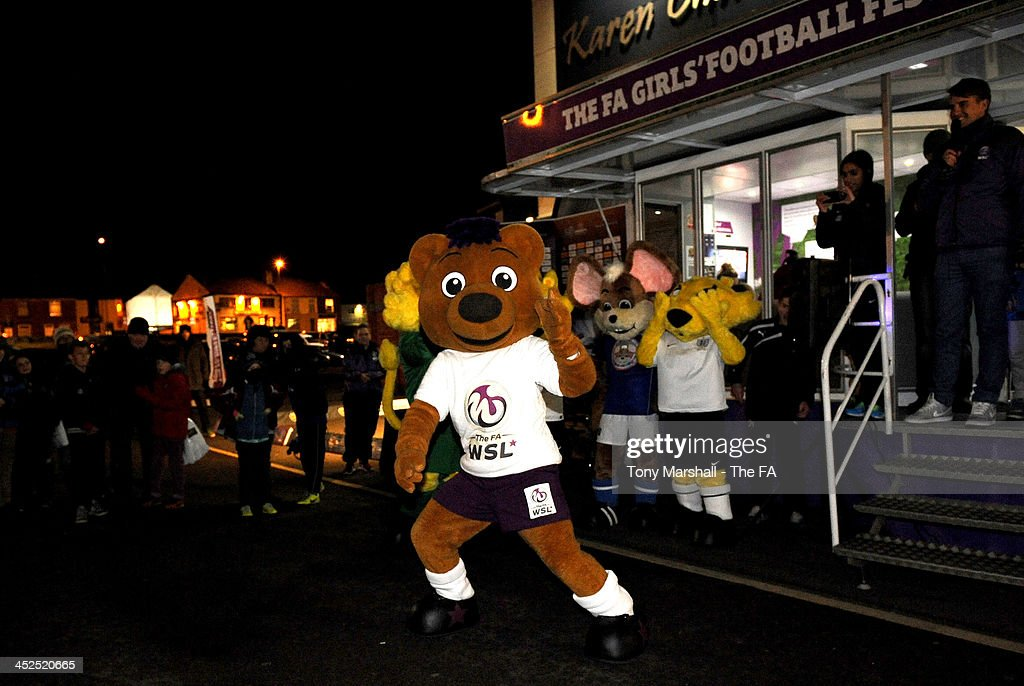 Berry the Bear takes part in the Mascots Dance Off at the FA Girls Fanzone before the UEFA Womens U17 Championship Finals match between England and Austria at Chesterfield FC Stadium on November 29, 2013 in Chesterfield, England.
