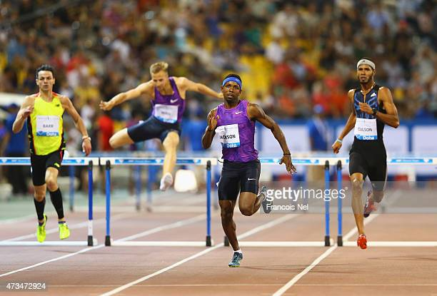 Bershawn Jackson of the United States races to the line ahead of Thomas Barr of Ireland Rasmus Magi of Estonia and Javier Coulson of Puerto Rico...