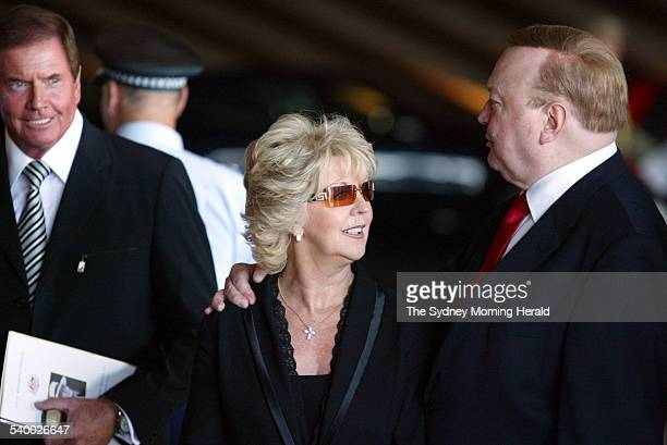 Bert and Patti Newton along with TV host John Burgess leave the State Memorial Service for Kerry Packer at the Sydney Opera House 17 February 2006...