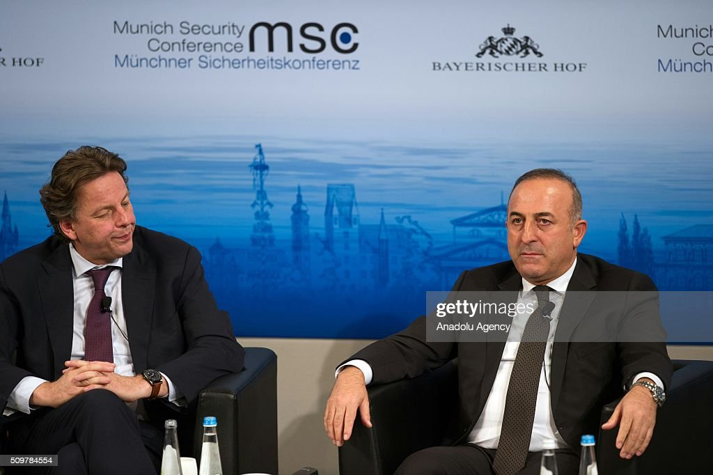 Bert Koenders (L), Minister of Foreign Affairs of the Netherlands, and Mevlut Cavusoglu, Minister of Foreign Affairs of Turkey attend the 2016 Munich Security Conference at the Bayerischer Hof hotel on February 12, 2016 in Munich, Germany. The annual event brings together government representatives and security experts from across the globe and this year the conflict in Syria will be the main issue under discussion.