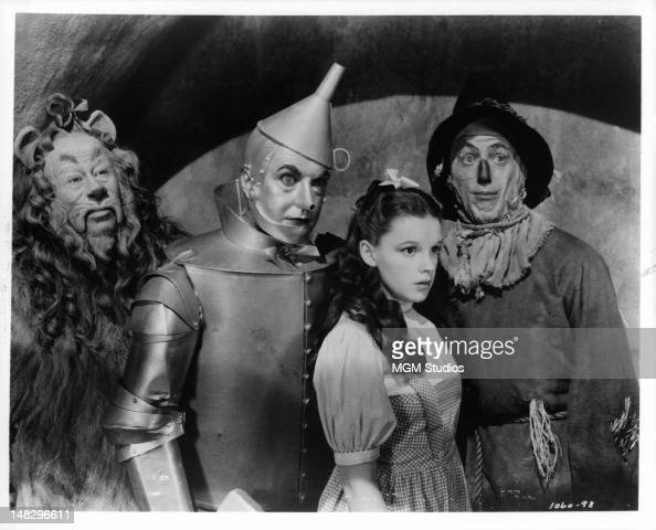 Bert Lahr as the Cowardly Lion Jack Haley as the Tin Man Judy Garland as Dorothy Gale and Ray Bolger as the Scarecrow in a scene from the film 'The...