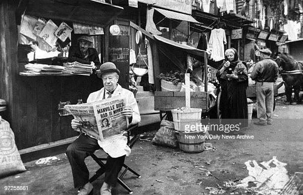 Bert Lahr reads a copy of the Daily News while taking a break from filming 'The Night They Raided Minsky's'