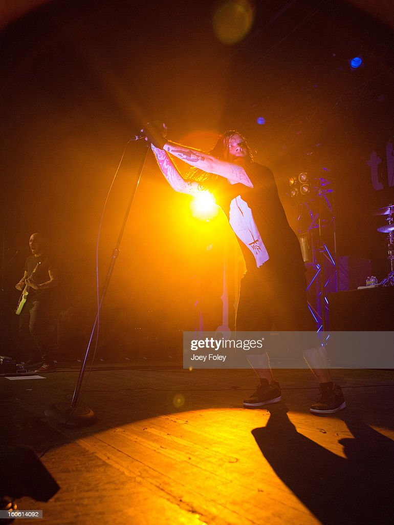 <a gi-track='captionPersonalityLinkClicked' href=/galleries/search?phrase=Bert+McCracken&family=editorial&specificpeople=2216927 ng-click='$event.stopPropagation()'>Bert McCracken</a> of The Used performs at the Murat Egyptian Room on January 20, 2013 in Indianapolis, Indiana.
