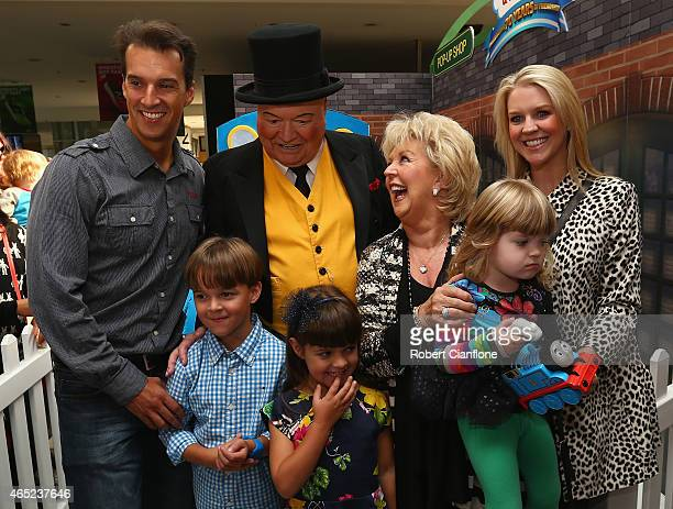 Bert Newton dressed as The Fat Controller poses with his family during the Thomas Friends 70th Birthday Celebration at Flinders Street Station on...