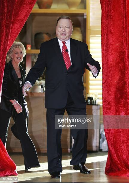 Bert Newton walks through the red curtain at the launch for 'Bert's Family Feud' TV show at Breezes on February 7 2006 in Melbourne Australia