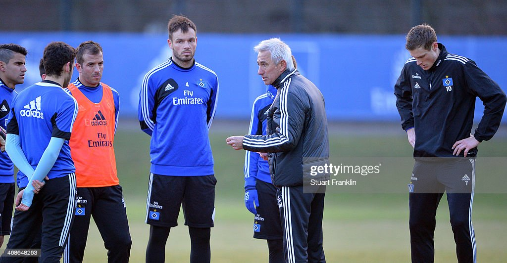 Bert van Marwijk, head coach of Hamburger SV ponders during the training session of Hamburger SV on February 11, 2014 in Hamburg, Germany.