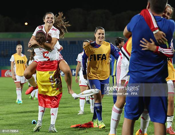 Berta Pujadas of Spain jumps on Natalia Ramos of Spain as they celebrate their victory during the FIFA U17 Women's World Cup Jordan 2016 Quarter...