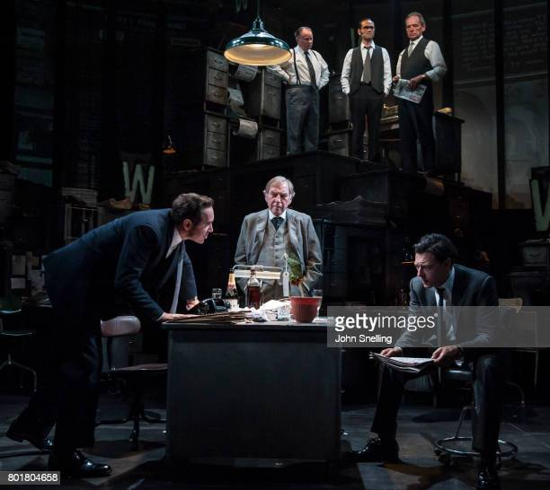 Bertie Carvel as Rupert Murdoch Geoffrey Freshwater as Sir Alick McKay and Richard Coyle as Larry Lamb with the Company perform on stage in a new...