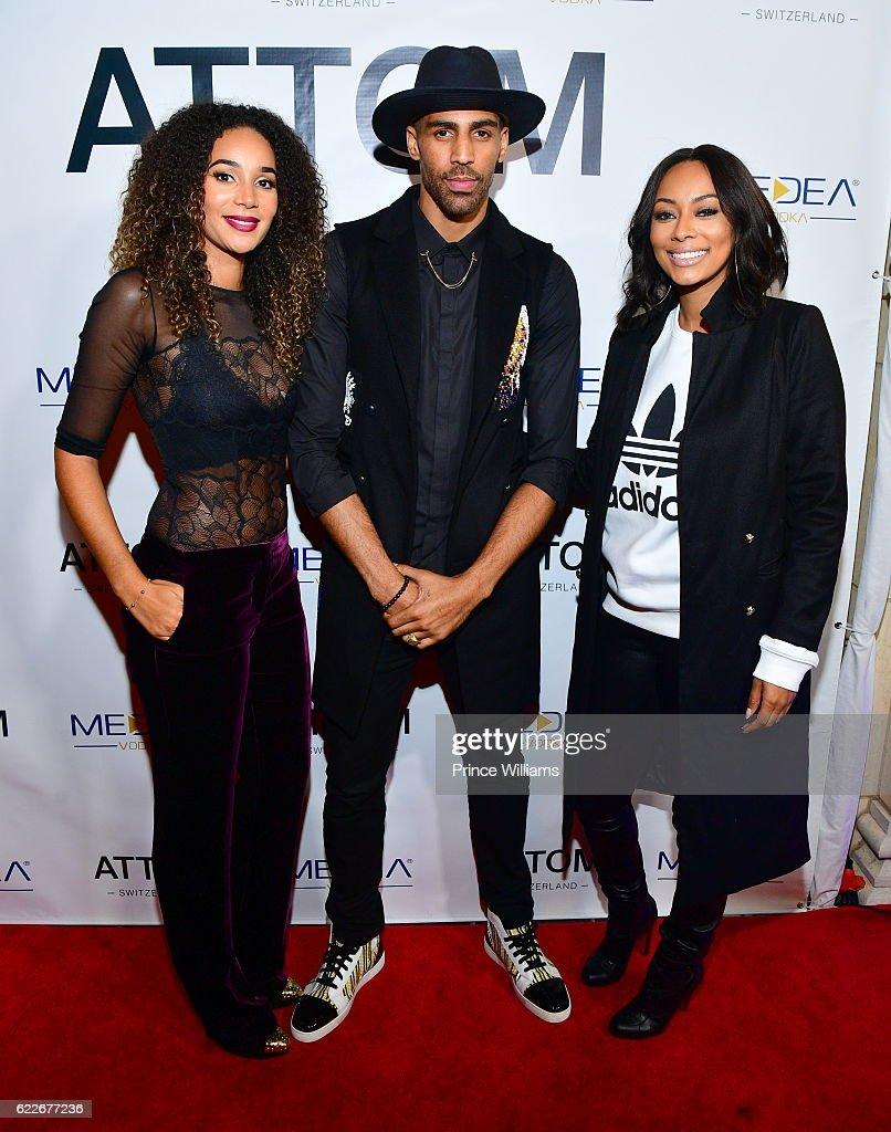 Bertille Sefolosha, Thabo Sefolosha and Keri Hilson attend the ATTOM Atlanta Store Private Opening on November 11, 2016 in Atlanta, Georgia.
