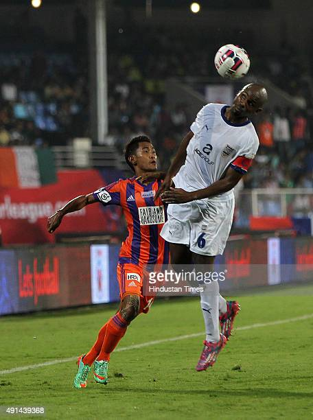 Bertin captain of Mumbai City FC trying header aimed at goal post on a corner kick against FC Pune City during the Indian Super League match at Shree...