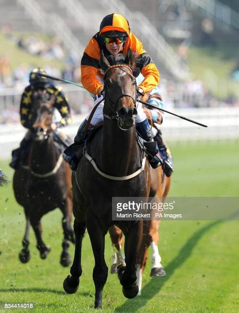 Bertoliver ridden by Philip Robinson wins The Breitling watches and Waltons of Chester Handicap Stakes during the totesportcom Chester Cup Day...