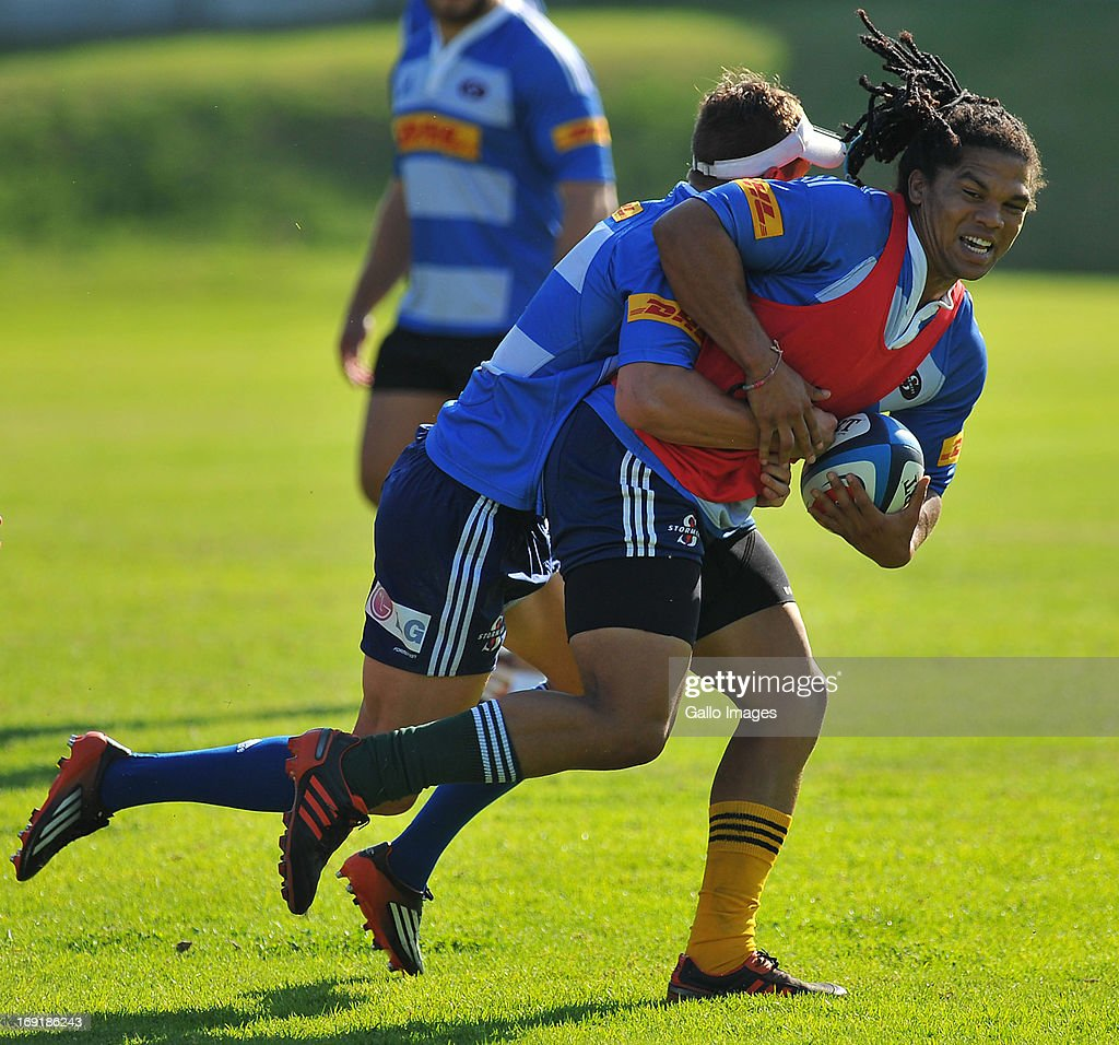 Berton Klaasen is tackled by Louis Schreuder during the DHL Stormers training session and press conference from High Performance Centre in Bellville on May 21, 2013 in Cape Town, South Africa.