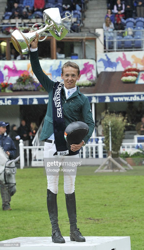 Bertram Allen of Ireland poses after winning the Longines International Grand Prix of Ireland riding Molly Malone V in a time of 39.67 during the final day of the Dublin Horse Show 2014 on August 10, 2014 in Dublin, Ireland.