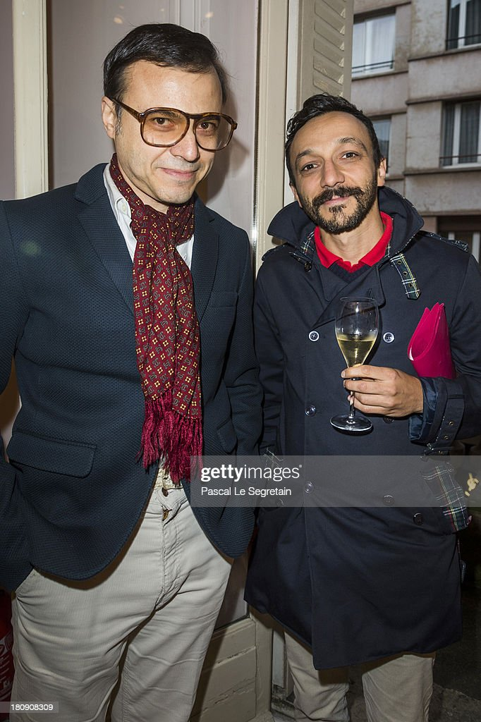 Bertrand Burgalat (L) and Benoit Forgeard attend the Vogue Fashion Night Out event at boutique Roger Vivier on 29 Faubourg Saint-Honore, on September 17, 2013 in Paris, France.