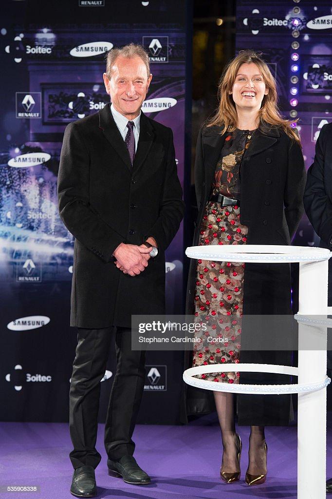 Bertrand Delanoe and Laetitia Casta launch the Champs-Elysees Christmas illuminations, in Paris