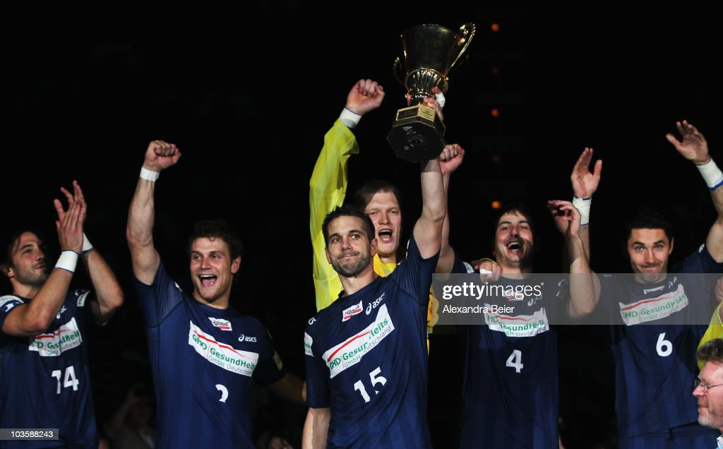Bertrand Gille, Michael Kraus, Guillaume Gille, Johannes Bitter, Domagoj Duvnjak and Blazenko Lackovic of Hamburg celebrate their victory of the Toyota Handball Supercup match between THW Kiel and HSV Handball at the Olympic hall on August 24, 2010 in Munich, Germany.