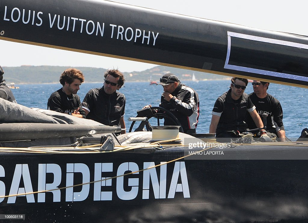 Bertrand Pace (C), skipper of French Aleph team returns to shore after colliding with a boat helmed by Italian team Azzura at the start of a Louis Vuitton Cup regatta on May 25, 2010 at La Maddalena island in Sardinia. Ten teams are battling it out over a two-week regatta until June 6.