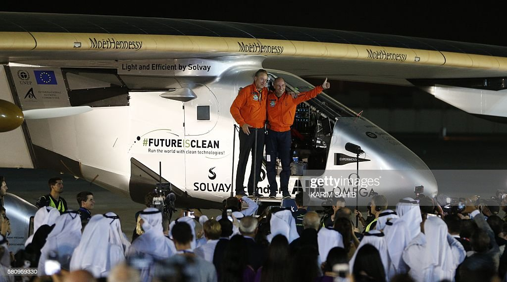 TOPSHOT Bertrand Piccard and Andre Borschberg pilots of the solar powered Solar Impulse 2 aircraft are greeted upon arrival at Al Batin Airport in...