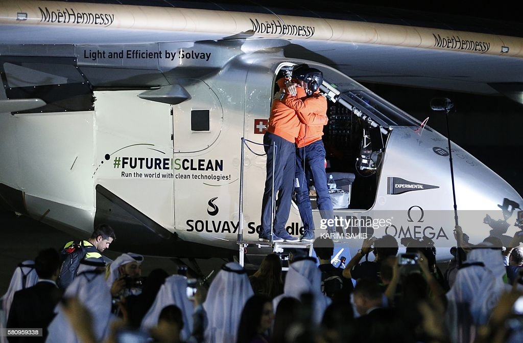 Bertrand Piccard and Andre Borschberg pilots of the solar powered Solar Impulse 2 aircraft are greeted upon arrival at Al Batin Airport in Abu Dabi...