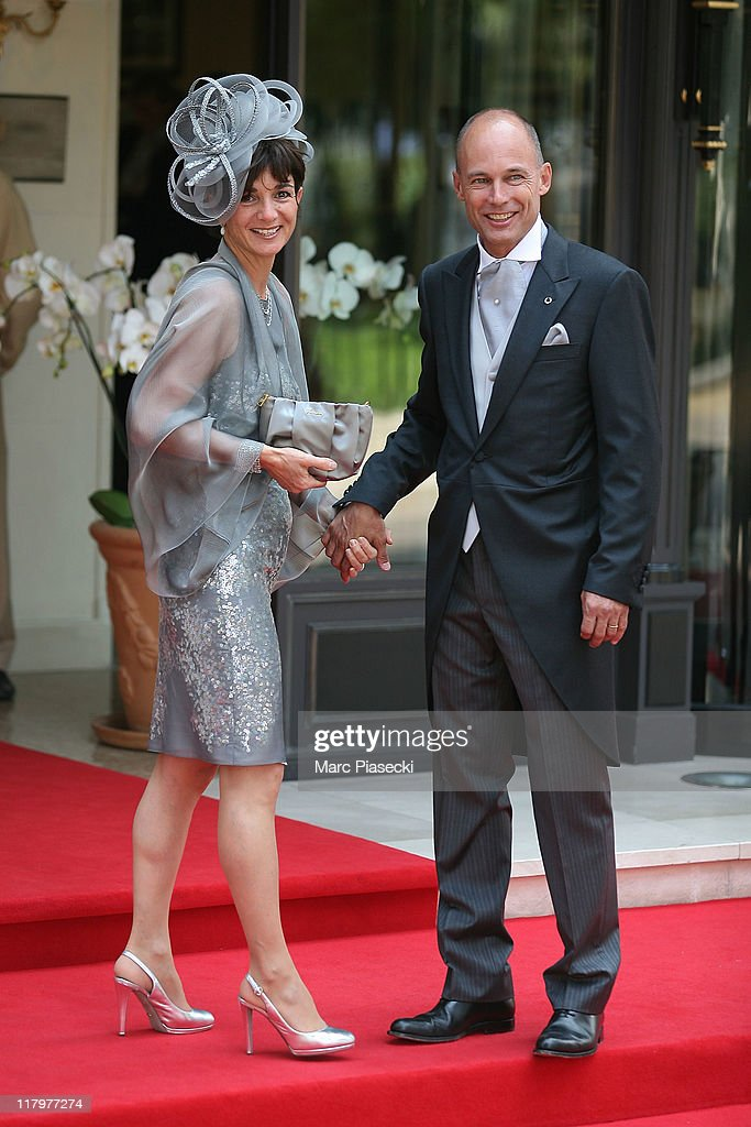 <a gi-track='captionPersonalityLinkClicked' href=/galleries/search?phrase=Bertrand+Piccard&family=editorial&specificpeople=773279 ng-click='$event.stopPropagation()'>Bertrand Piccard</a> and his wife Michele Piccard are sighted at the 'Hermitage' hotel to attend the Royal Wedding of <a gi-track='captionPersonalityLinkClicked' href=/galleries/search?phrase=Prince+Albert+II+of+Monaco&family=editorial&specificpeople=201707 ng-click='$event.stopPropagation()'>Prince Albert II of Monaco</a> to <a gi-track='captionPersonalityLinkClicked' href=/galleries/search?phrase=Charlene+-+Princess+of+Monaco&family=editorial&specificpeople=726115 ng-click='$event.stopPropagation()'>Charlene</a> Wittstock in the main courtyard at on July 2, 2011 in Monaco, Monaco.