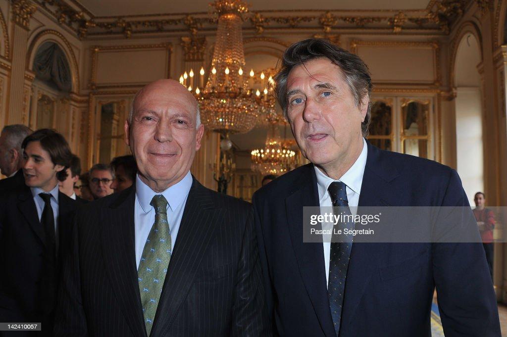 Bertrand Rindoff Petroff Officier des Arts et Des Lettres (L) and Bryan Ferry (R) pose at Ministere de la Culture on April 4, 2012 in Paris, France.