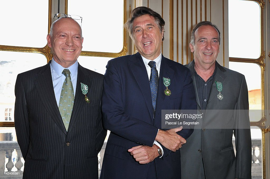 Bertrand Rindoff Petroff Officier des Arts et Des Lettres , Bryan Ferry and Yves Lecoq pose after being awarded by French Culture Minister at Ministere de la Culture on April 4, 2012 in Paris, France.
