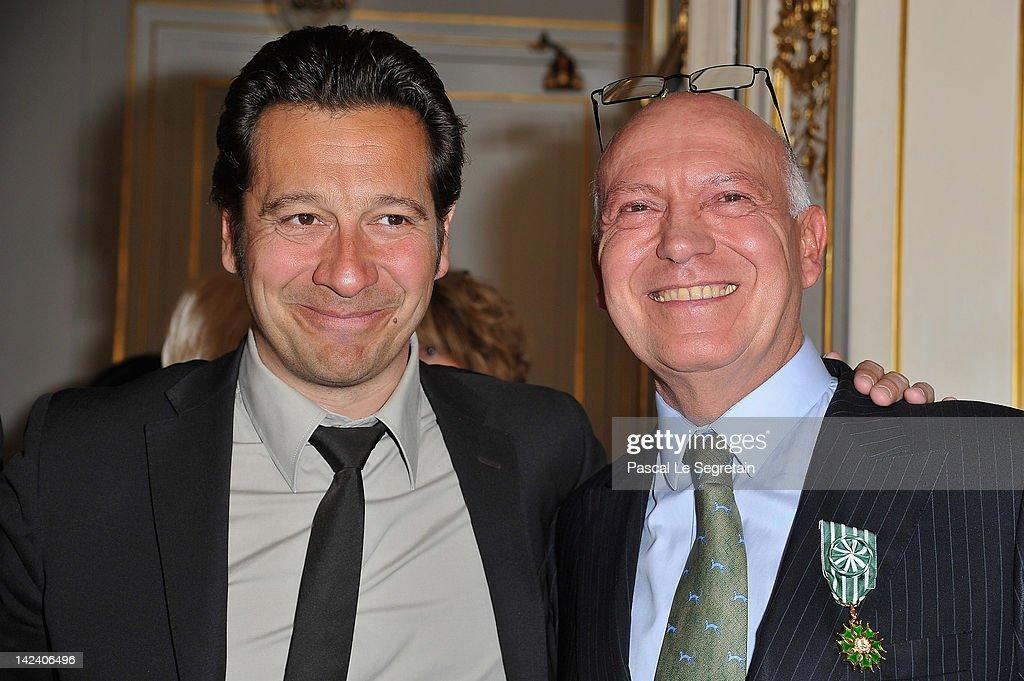 Bertrand Rindoff Petroff Officier des Arts et Des Lettres (R) honored Chevalier Des Arts et Lettres by French Culture Minister poses with Laurent Gerra (L) at Ministere de la Culture on April 4, 2012 in Paris, France.