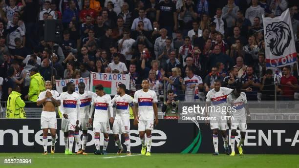 Bertrand Traoré of Olympique Lyonnais Lyon celebrates scoring a goal with his team mates during the UEFA Europa League group E match between...