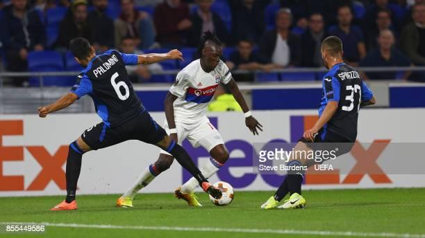 Bertrand Traor of Olympique Lyonnais Lyon takes on Jos Luis Palomino and Leonardo Spinazzola of Atalanta during the UEFA Europa League group E match...