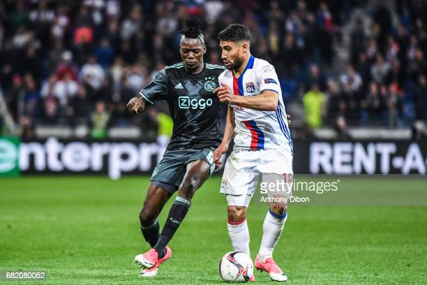 Bertrand Traore of Ajax and Nabil Fekir of Lyon during the Uefa Europa League semi final second leg match between Olympique Lyonnais Lyon and Ajax...