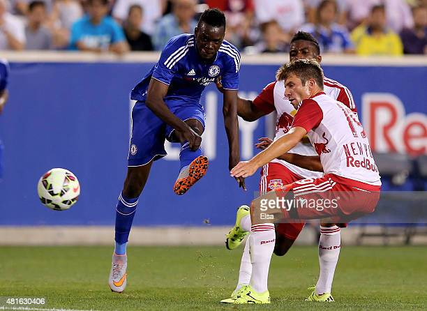 Bertrand Traore of Chelsea takes a shot as Leo Stolz of the New York Red Bulls defends during the International Champions Cup at Red Bull Arena on...