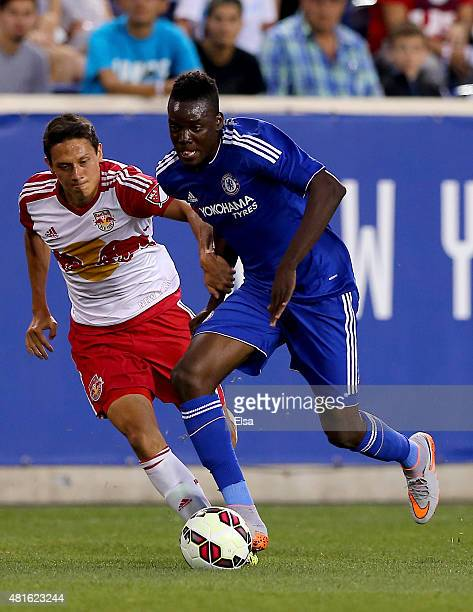 Bertrand Traore of Chelsea takes the ball as Sean Davis of New York Red Bulls defends during the International Champions Cup at Red Bull Arena on...