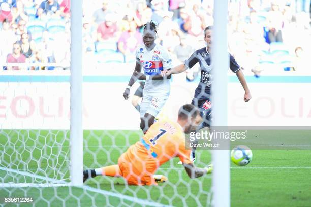 Bertrand Traore of Lyon sees his shot saved by Benoit Costil of Bordeaux during the Ligue 1 match between Olympique Lyonnais and FC Girondins de...