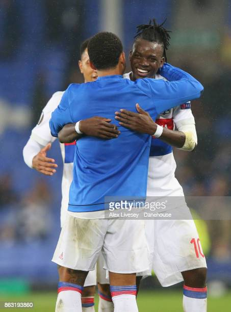 Bertrand Traore of Olympique Lyon celebrates with Memphis Depay after the UEFA Europa League group E match between Everton FC and Olympique Lyon at...