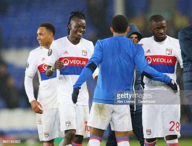Bertrand Traore of Olympique Lyon celebrates with Memphis Depay and Tanguy Ndombele after the UEFA Europa League group E match between Everton FC and...